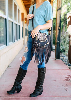 Trinity Ranch Coffee Studded Fringe Crossbody Handbag on model