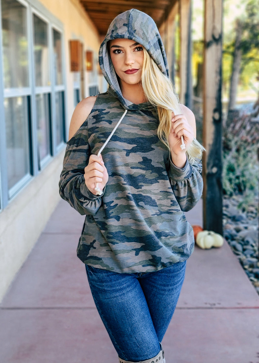 Camo Cold Shoulder Hoodie on blonde model with denim jeans