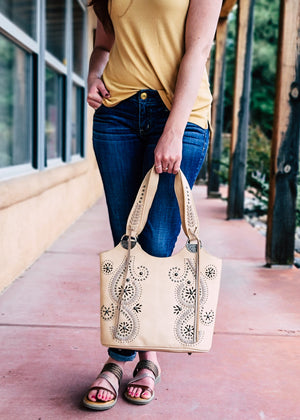 Tan Whip Stitched Concealed Carry Handbag with model