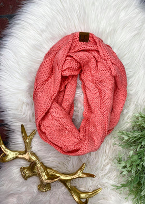 Coral Cable Knit Infinity Scarf on white rug