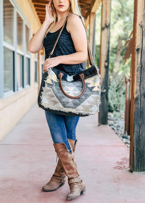 Aztec Cowhide Weekender Bag on model outside