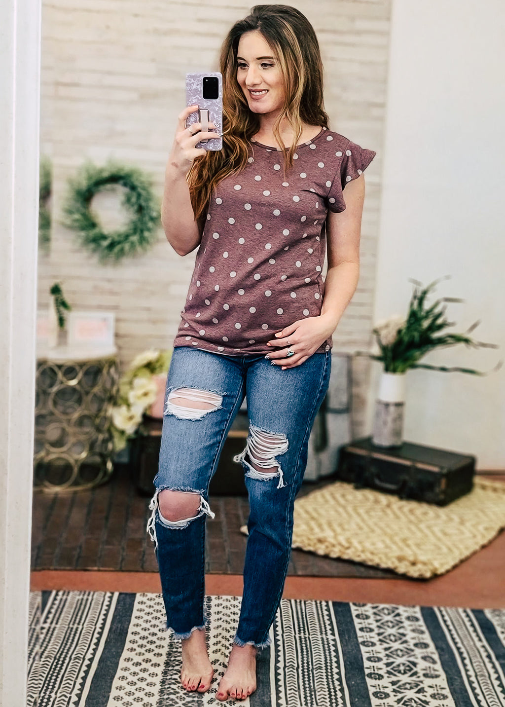 Dark Mauve Polka Dot Short Sleeve Top on model with distressed jeans