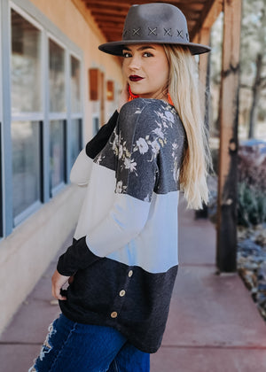 Floral Color Block Dolman Long Sleeve Top on blonde model with accessories
