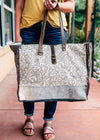 Grey Paisley Cowhide Weekender Bag on model, shot outside