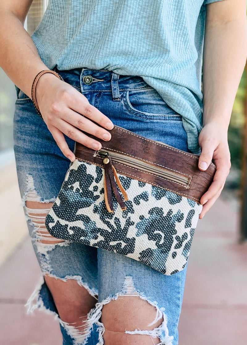 Ivory Pattern Pouch/Wristlet with model