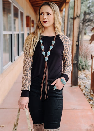 Black Leopard Long Sleeve Top on model with turquoise jewelry