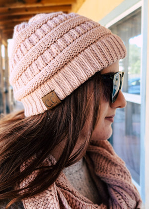 pink knit beanie on model