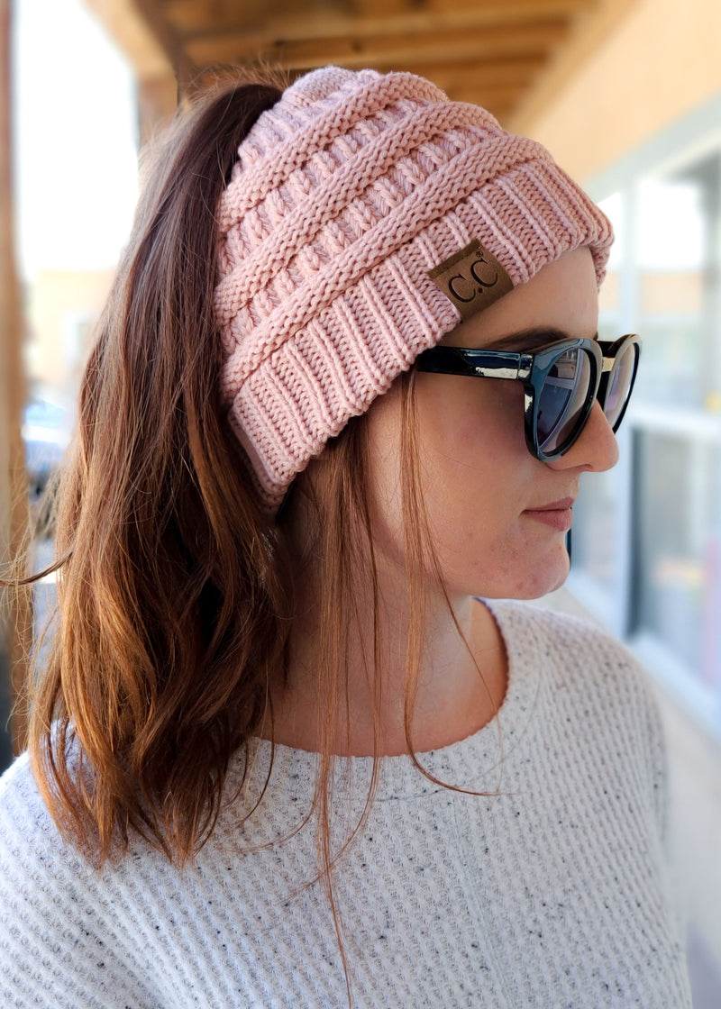 Light Pink Ponytail Beanie on rug