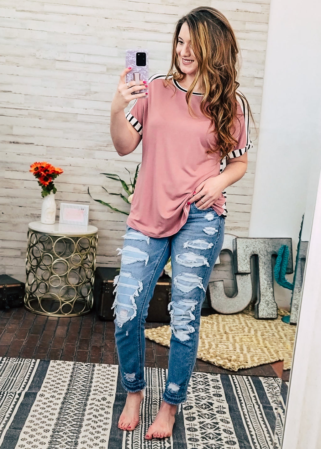 Mauve Striped Short Sleeve Top with brunette model wearing distressed jeans