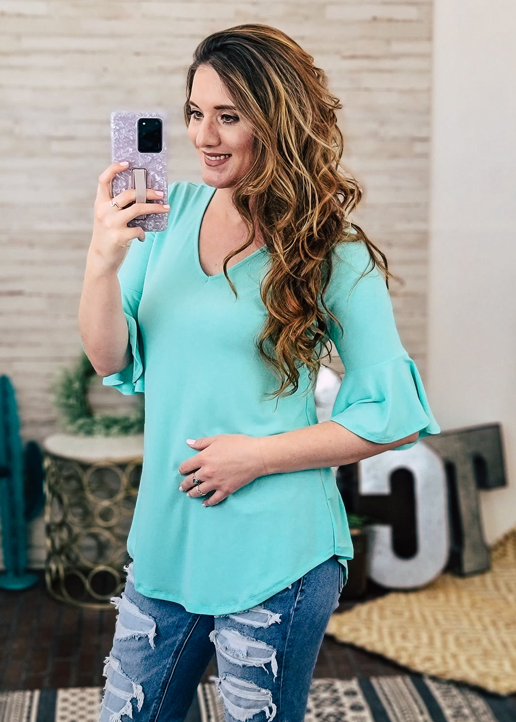 Mint Bell Sleeve Top on model