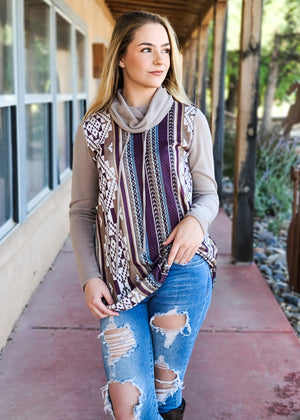 Mocha Aztec Cowl Neck Top on blonde model with distressed jeans and brown tall boots