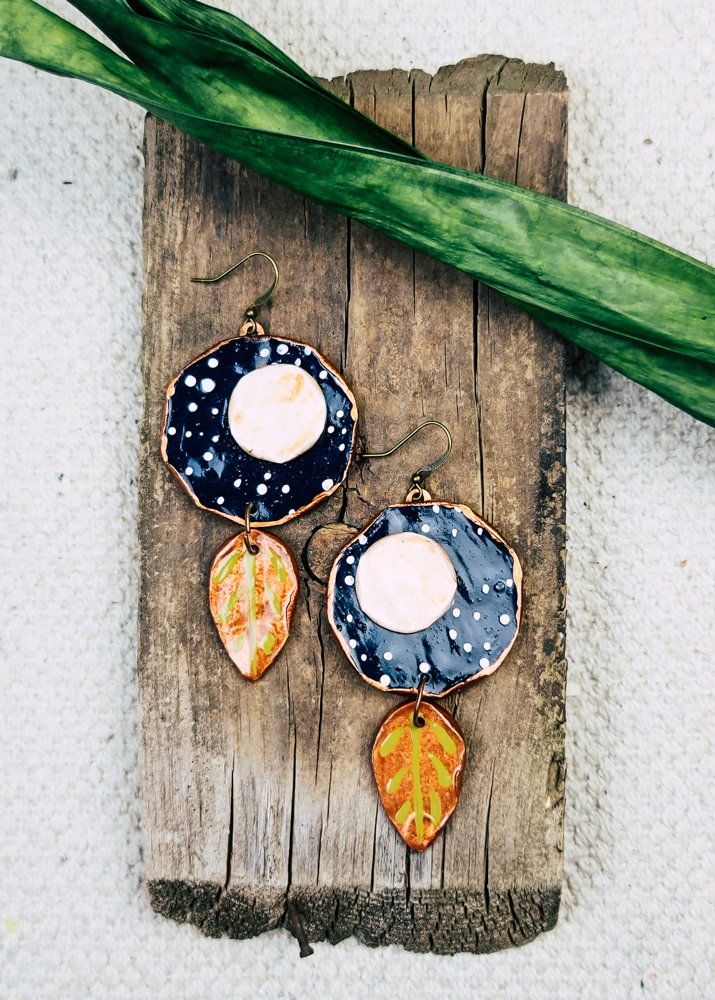 Moon & Stars Earrings on wood piece