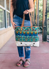 Multi Colored Aztec Patterned Handbag on model, shot outside