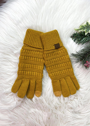 Mustard Knit Gloves on rug