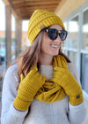 mustard matching beanie, gloves and scarf on model