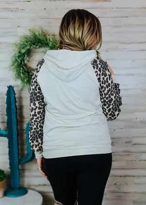 Oatmeal Leopard Hoodie with blonde model and accessories