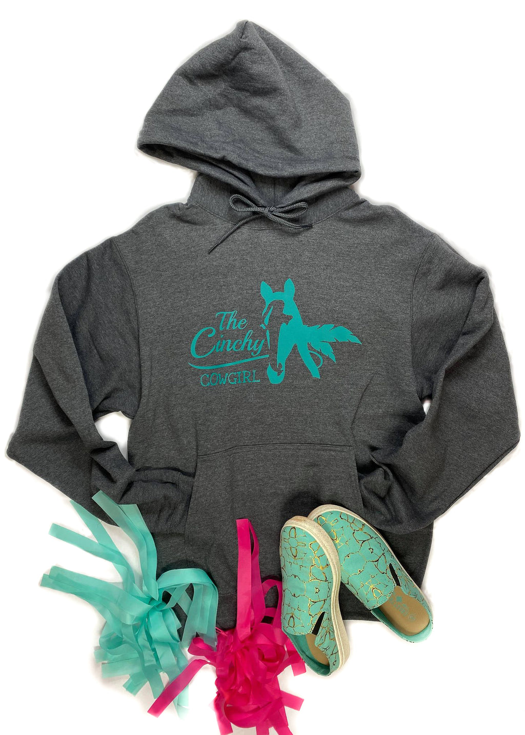 Dark Grey unisex hoodie with The Cinchy Cowgirl and horse outline in teal ink laid flat on white surface