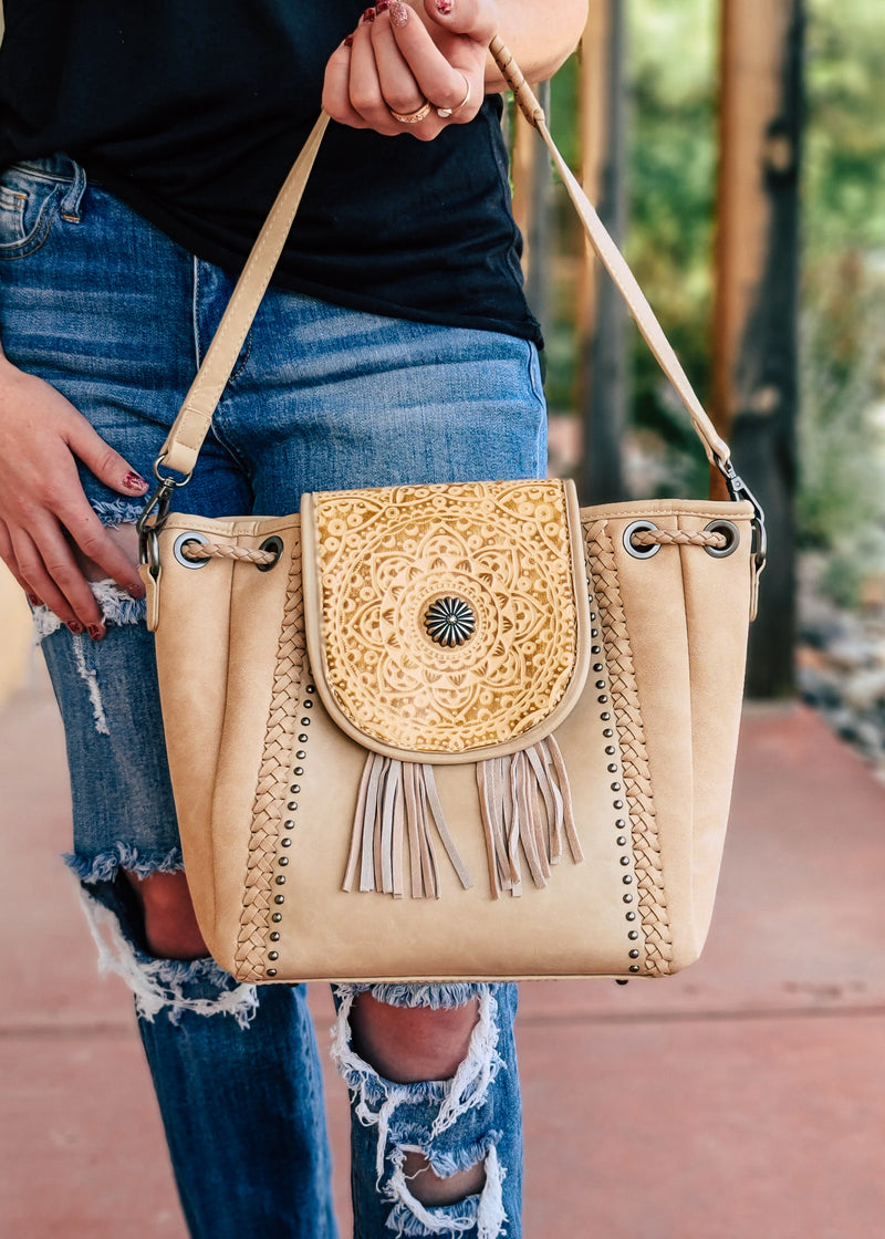 Concealed Carry Tan Mandala Tooled Crossbody/Hobo Handbag with model, shot outside