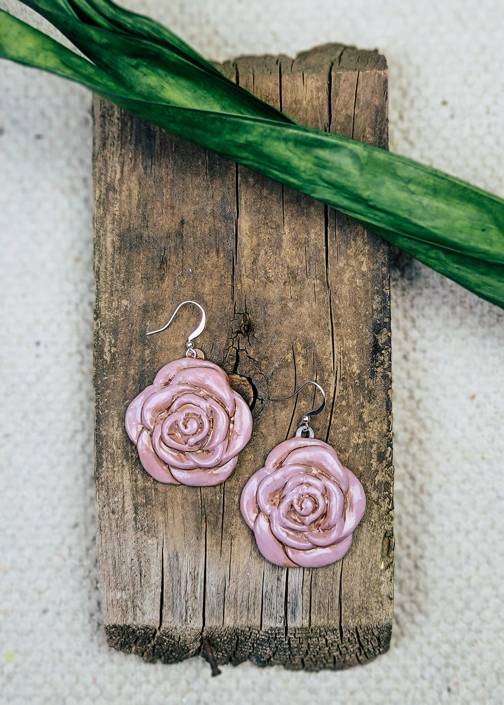 Violet Rose Earrings on wood piece