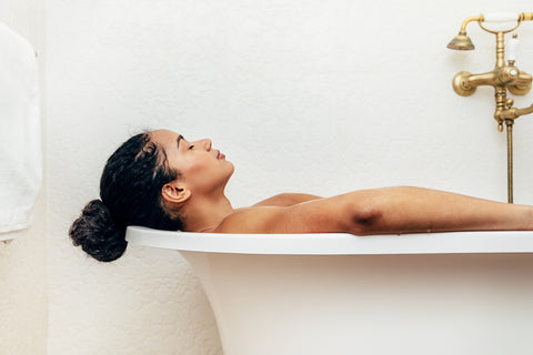 Woman in Himalayan salt sole bath