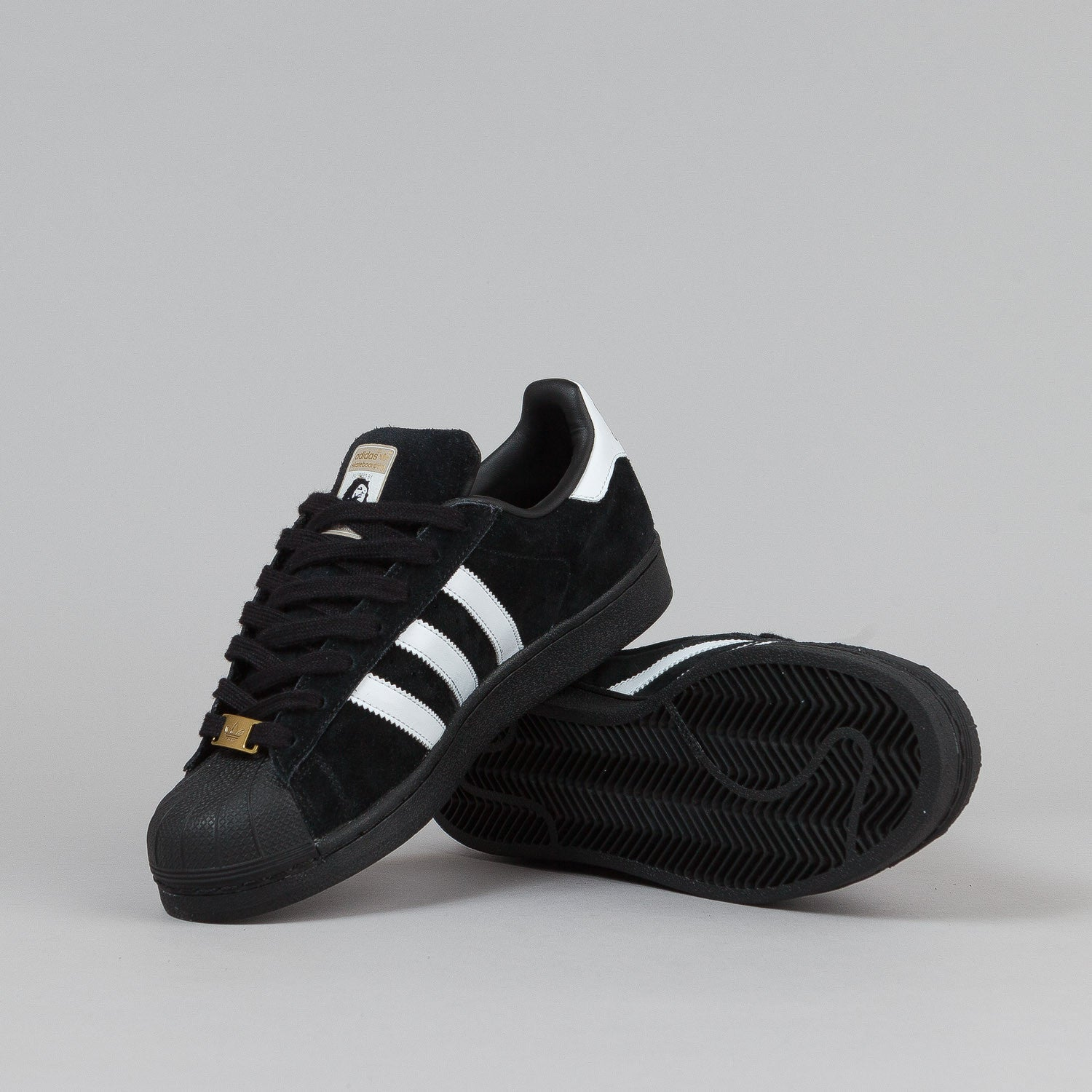 huge selection of b4645 fe859 black adidas superstar shoes with gold stripes Norwescap