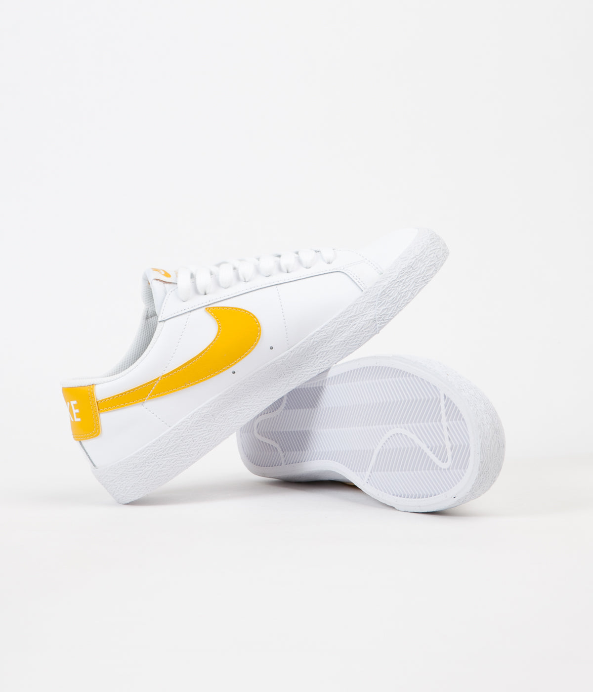 6fc017a568ab ... Nike SB Blazer Low Shoes - White   Mineral Gold ...