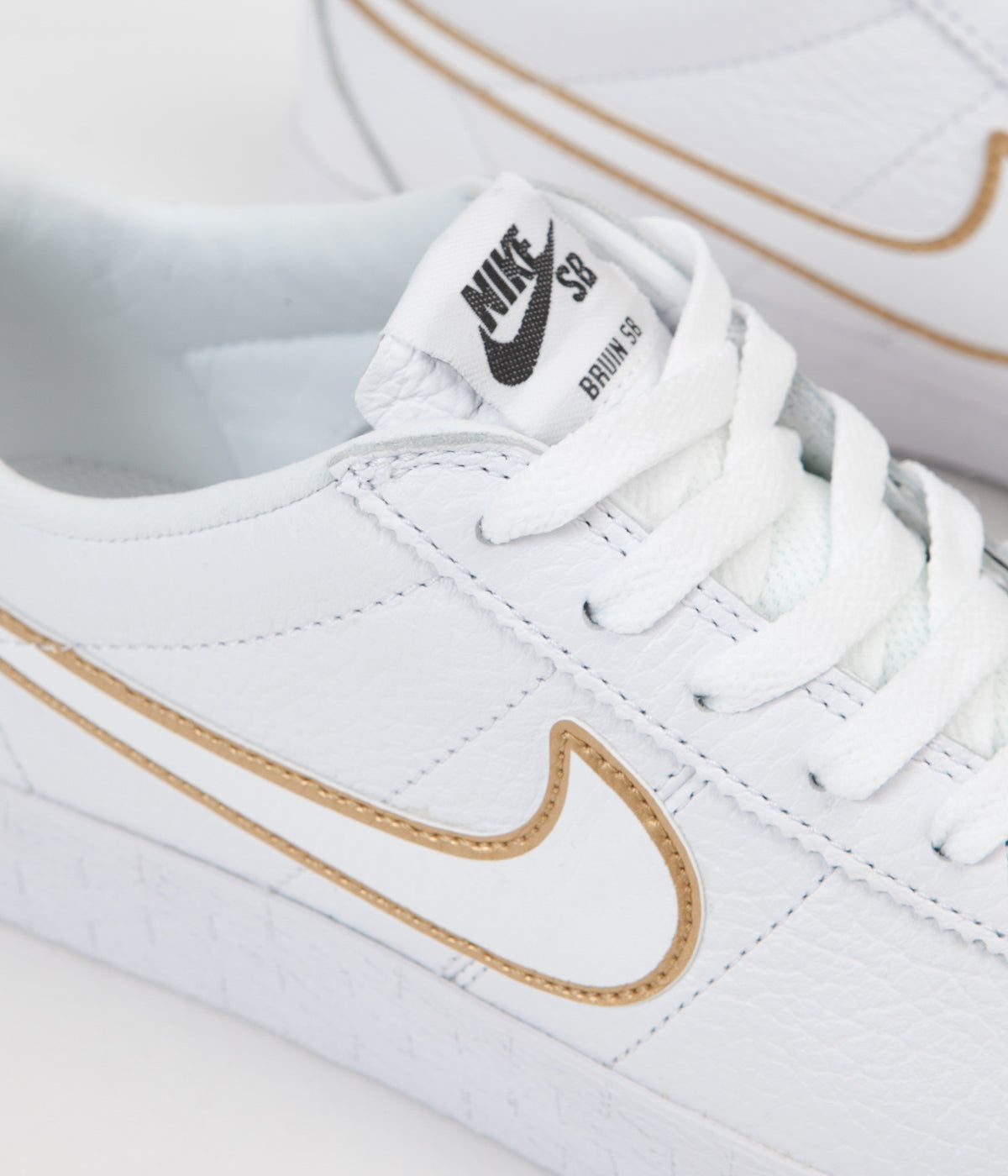 arrives 58588 bb567 ... Nike SB Bruin Premium SE Shoes - White   White - Metallic Gold - Black  ...