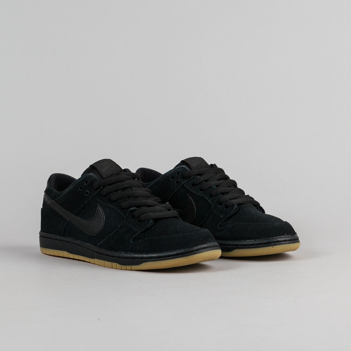 a9909a5a293a nike dunk low black gum
