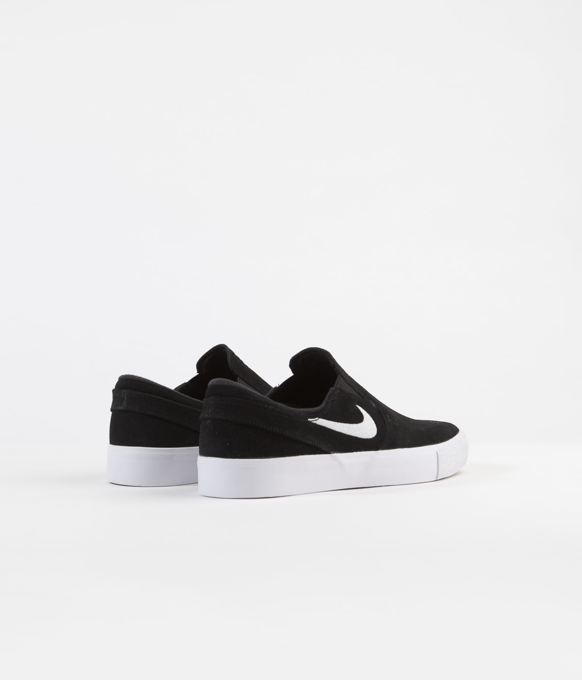 Nike SB Janoski Slip On Remastered Shoes - Black / White - White