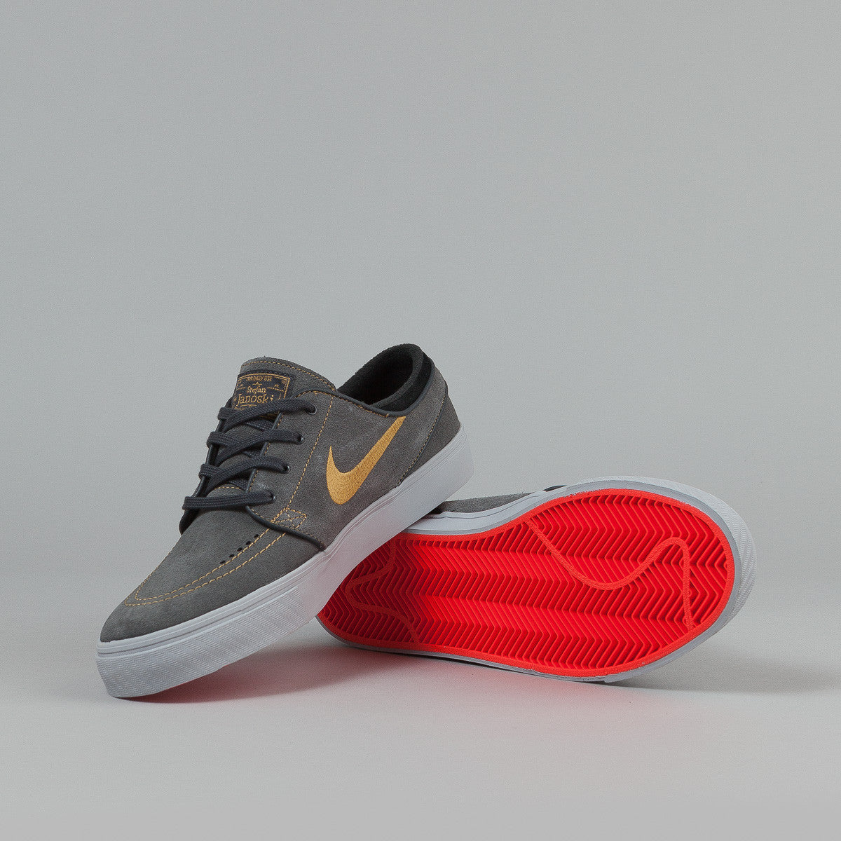 Nike SB Stefan Janoski Shoes - Anthracite / Metallic Gold - Black - Bright Crimson
