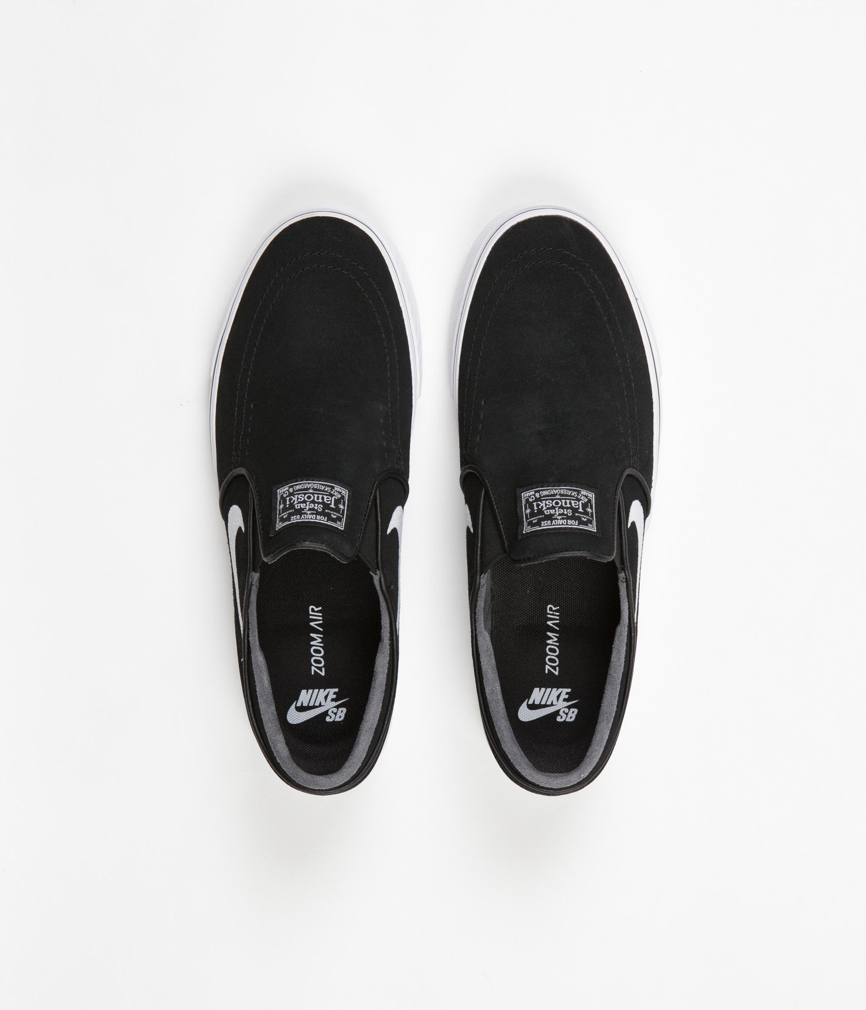 Nike SB Stefan Janoski Slip On Shoes - Black / White