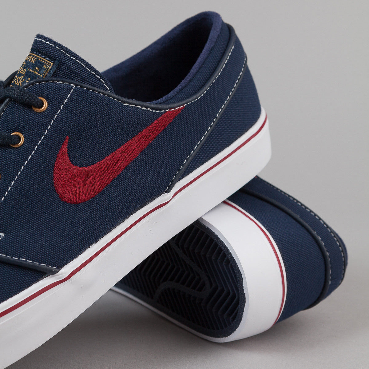 Nike SB Stefan Janoski Shoes - Obsidian / White / Metallic Gold / Team Red