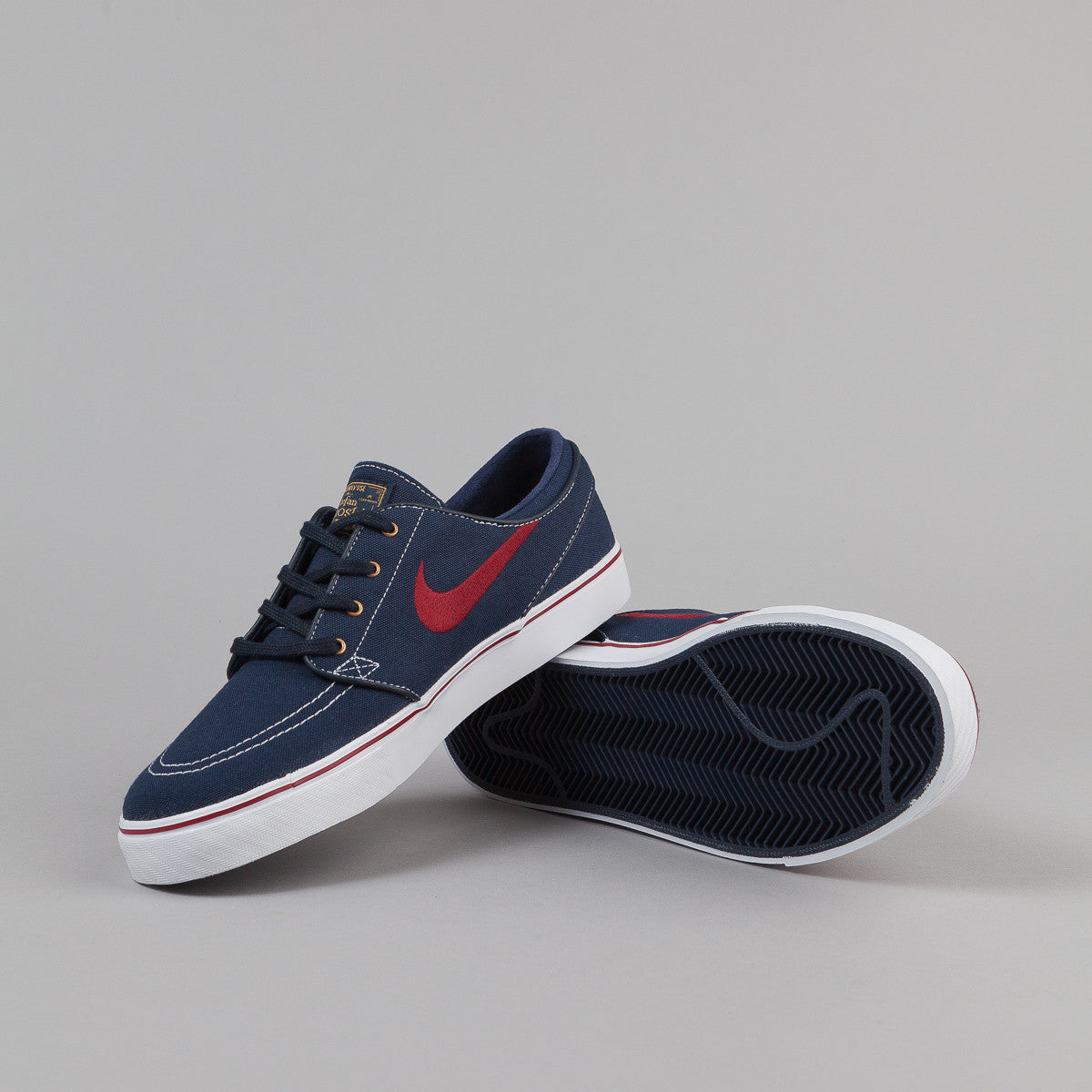 promo code 19f00 11217 metallic grey red nike stefan janoski shoes