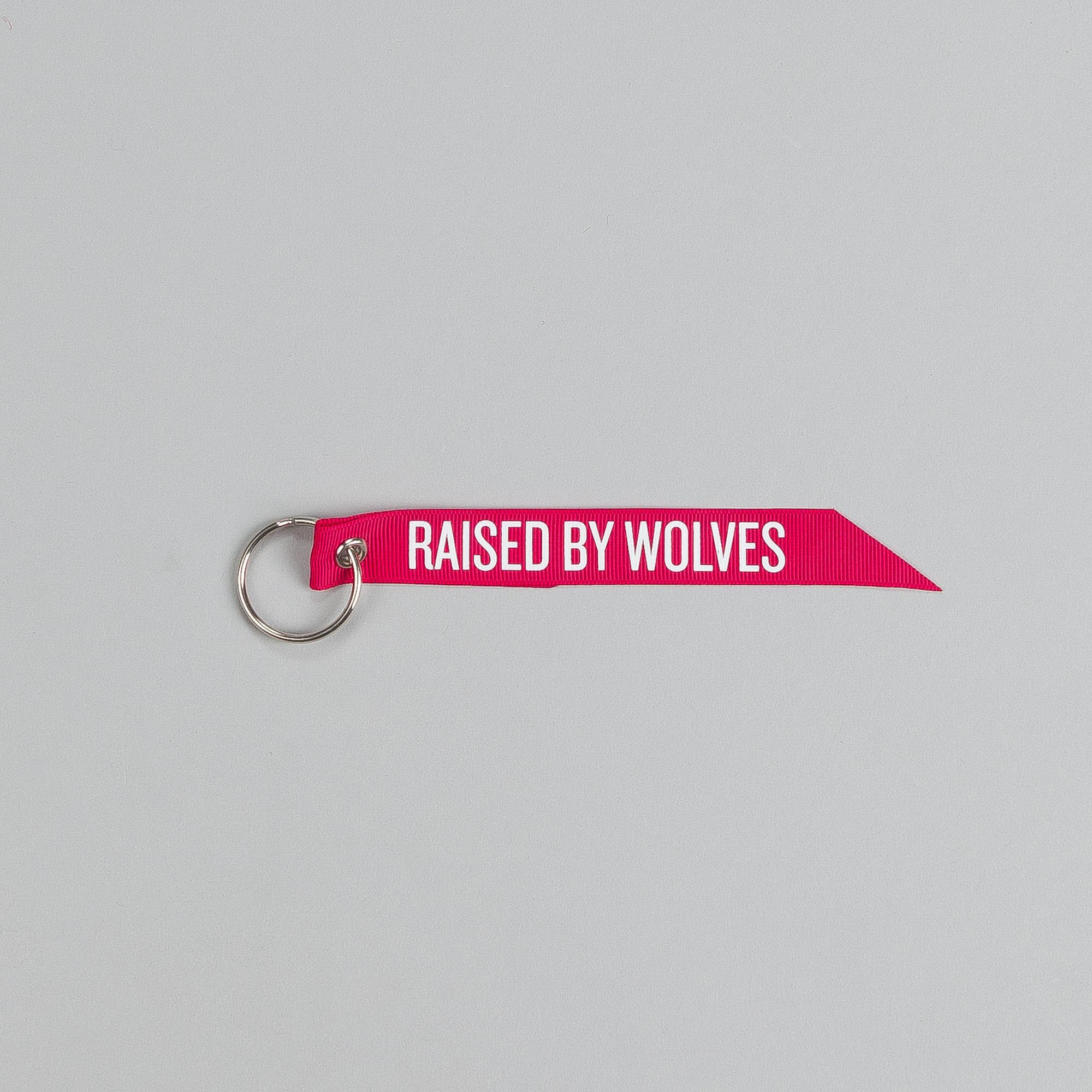 Raised By Wolves Flight Tab Key Chain Red