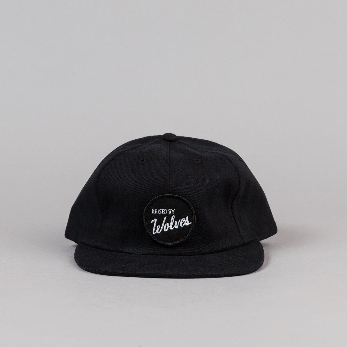 Raised By Wolves Varsity Polo Cap - Black Sanded Brush Twill