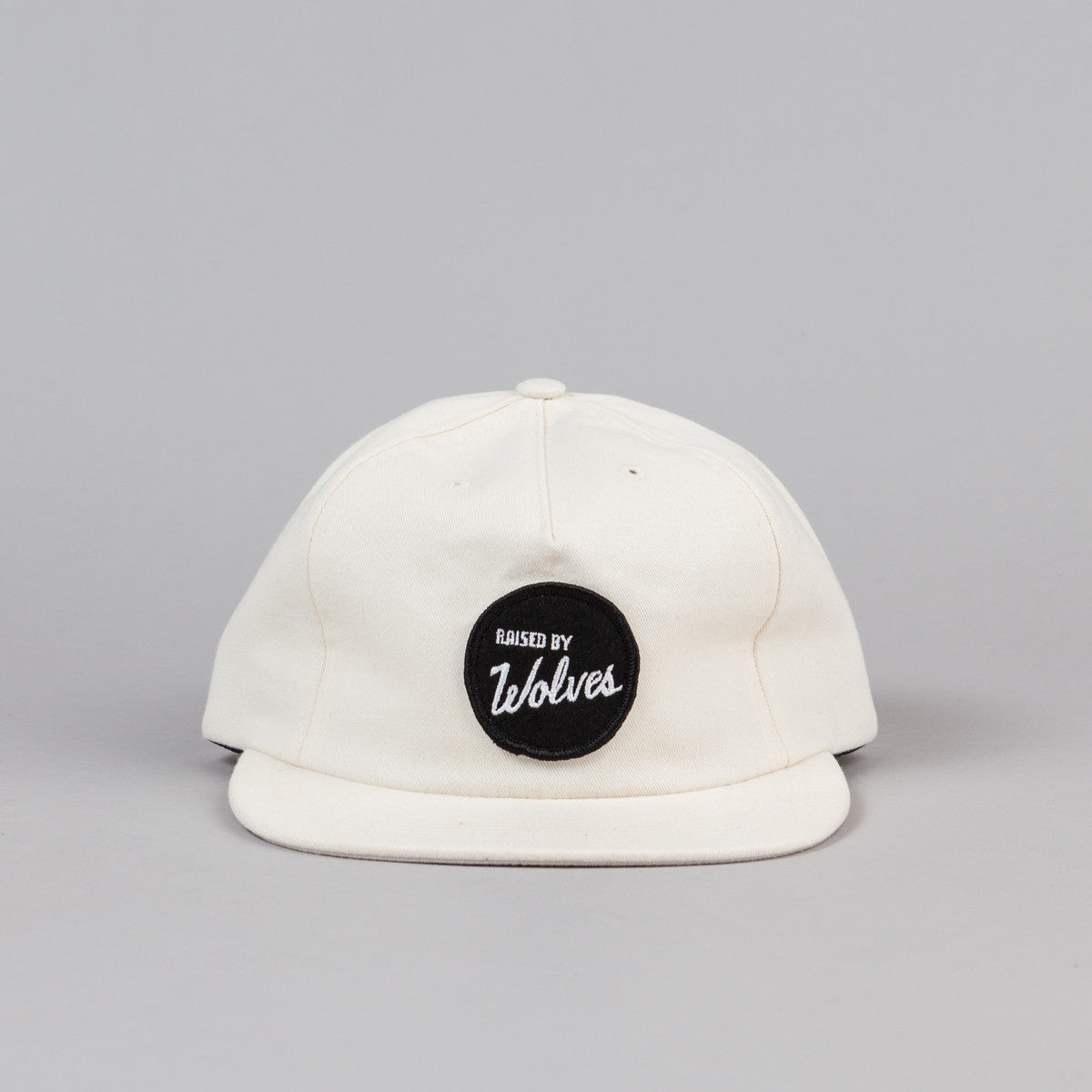 Raised By Wolves Varsity Polo Cap - Vanilla Saded Brush Twill