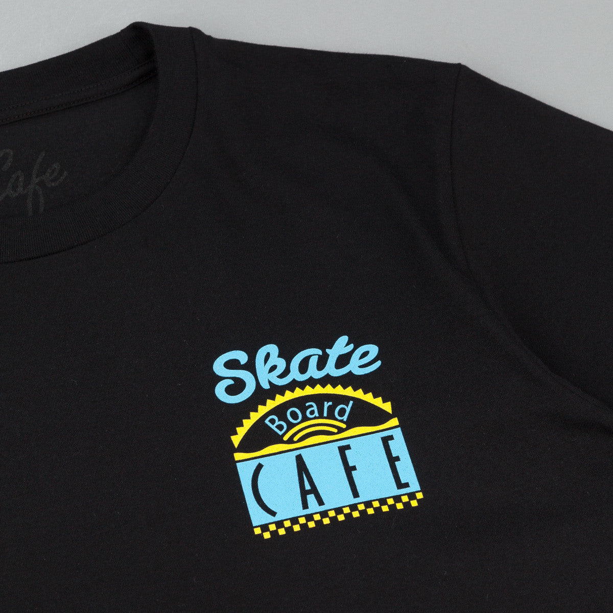 Skateboard Cafe Diner T-Shirt - Black / Blue / Yellow
