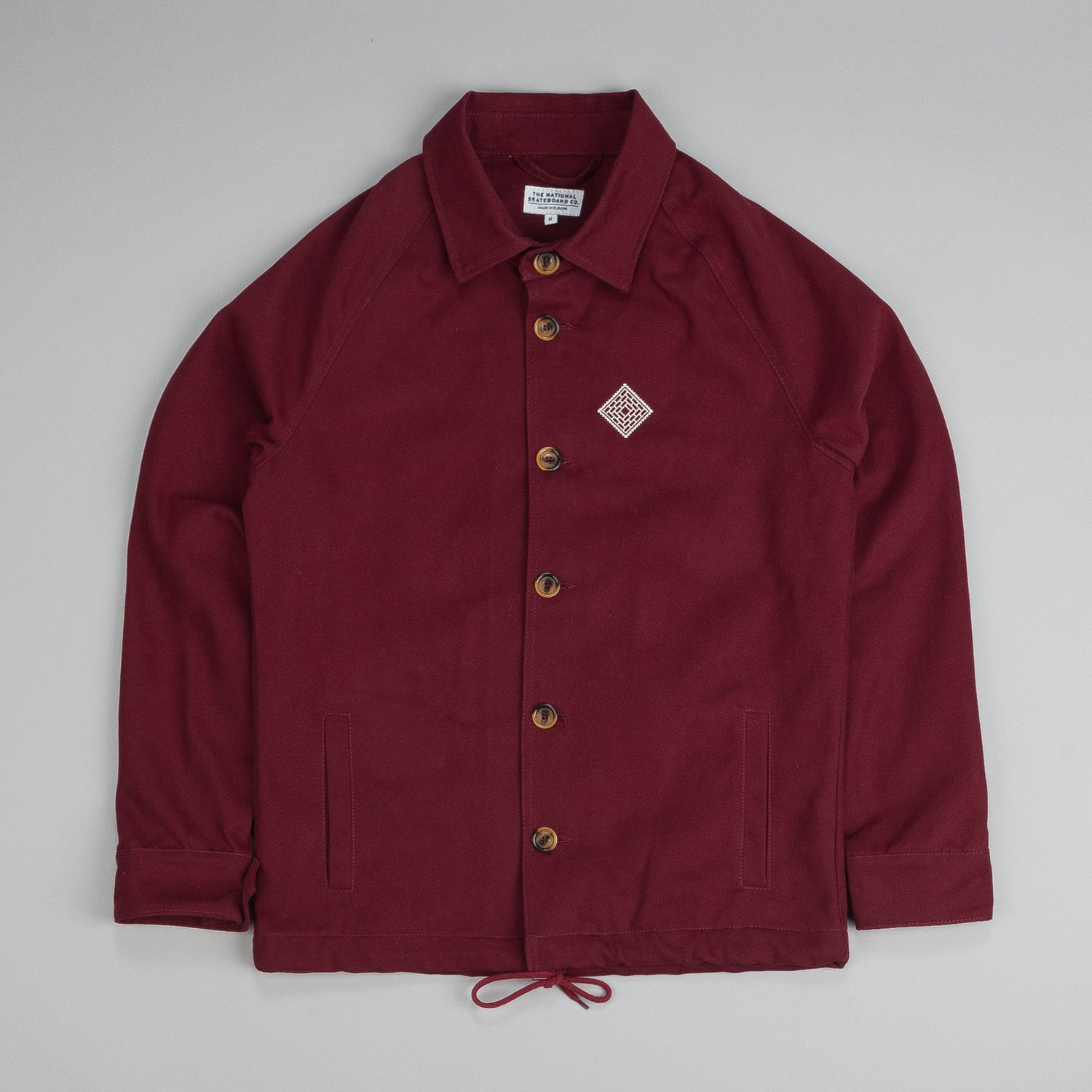 The National Skateboard Co X Post Coach Jacket Burgundy