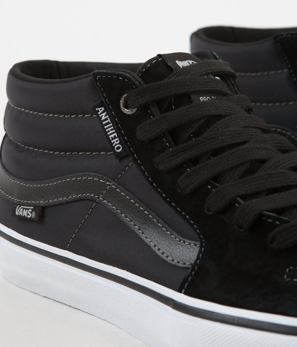 90be7a6c6a ... Vans x Anti Hero Sk8-Mid Pro Shoes - Grosso   Black ...
