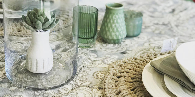 A dining table with dishware and decorations