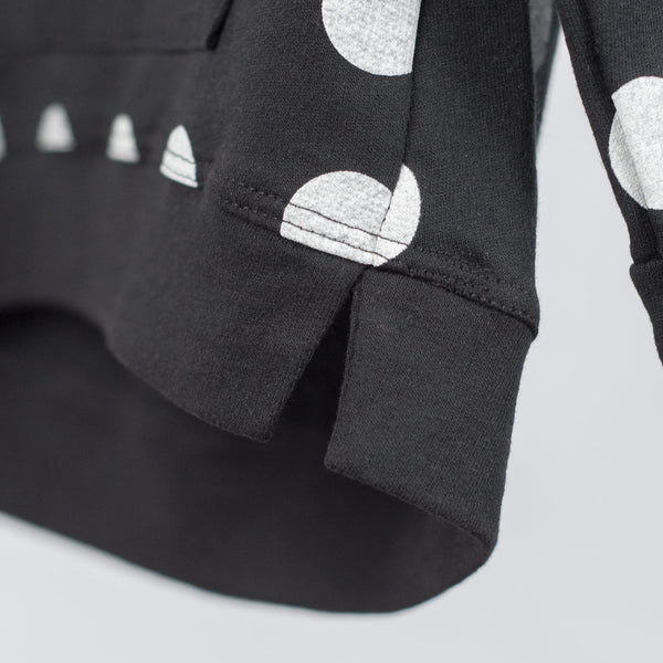 kids black sweatshirt with white polka dots and split bottom hem detail