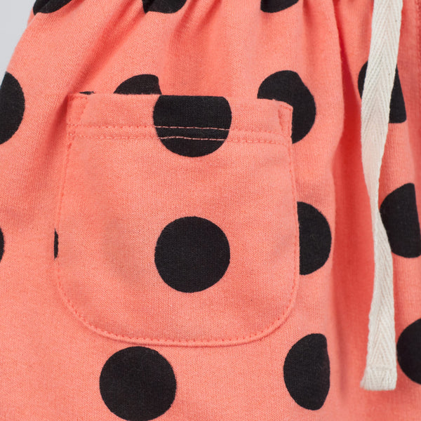 kids coral skirt with black polka dots and front pocket detail