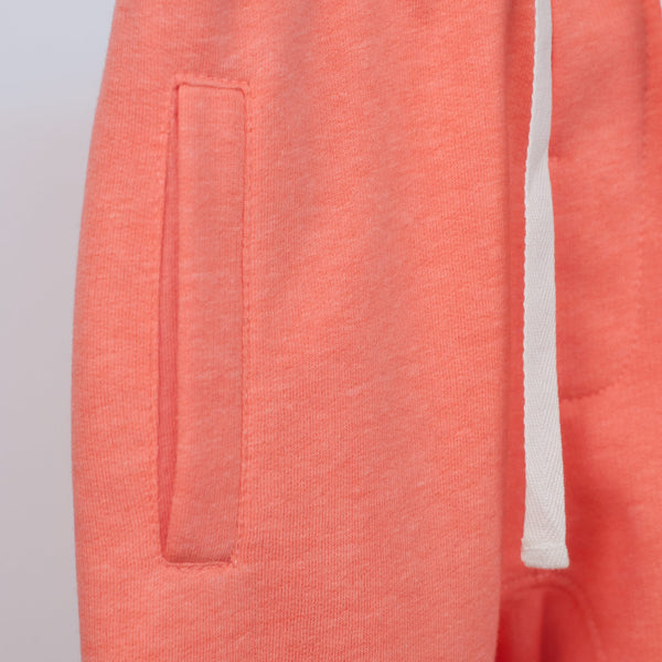 front pocket detail on coral joggers