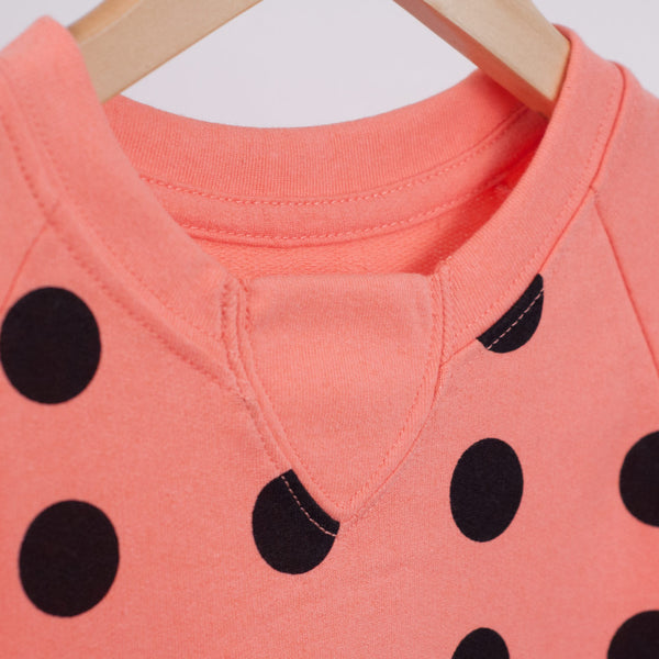 signature rib inset detail on coral t-shirt dress with black polka dots