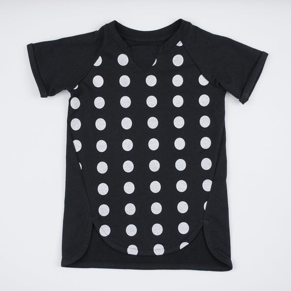kids short sleeve black t-shirt dress with white polka dots and curved hem detail
