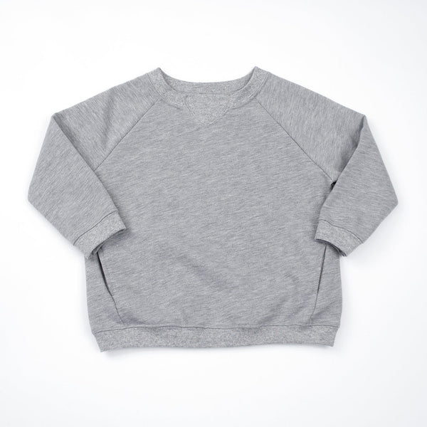 boy in kids grey raglan sweatshirt
