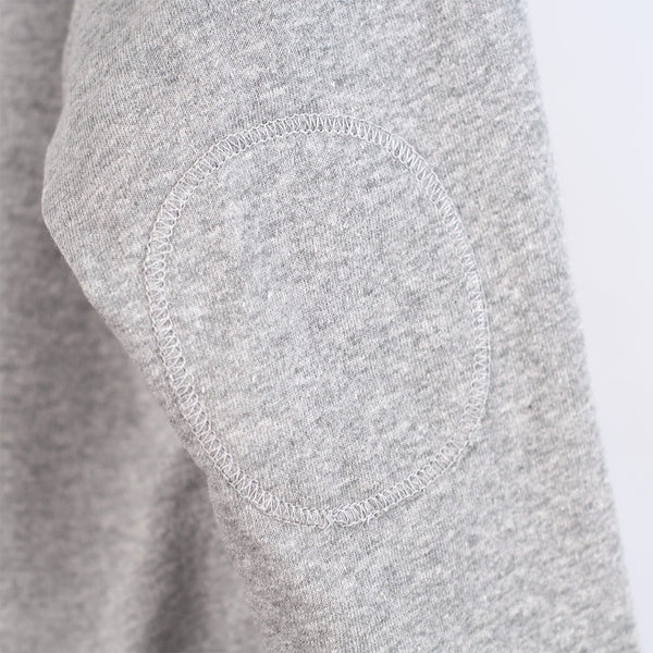 circular elbow patch of kids grey cardigan
