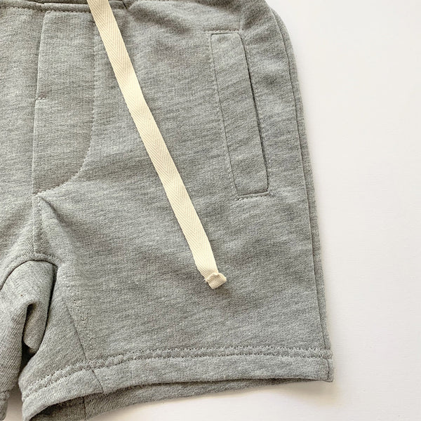 kids drawstring sweat shorts with two front pockets in grey