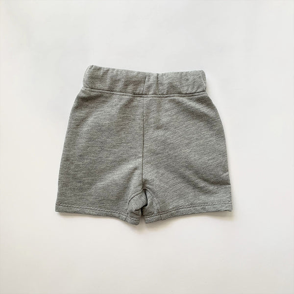 back view of kids drawstring sweat shorts with two front pockets in grey