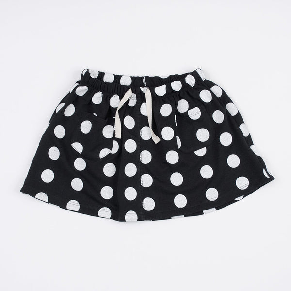 kid's black skirt with white polka dots and front pockets and pull through drawstring